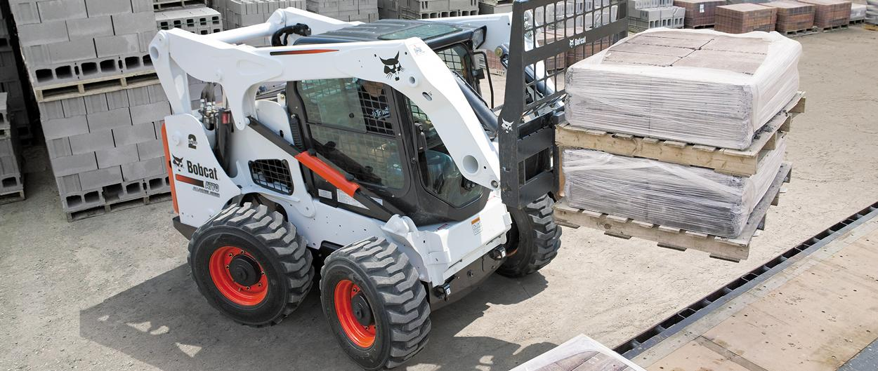 Bobcat A770 all-wheel steer loader with pallet fork attachment.