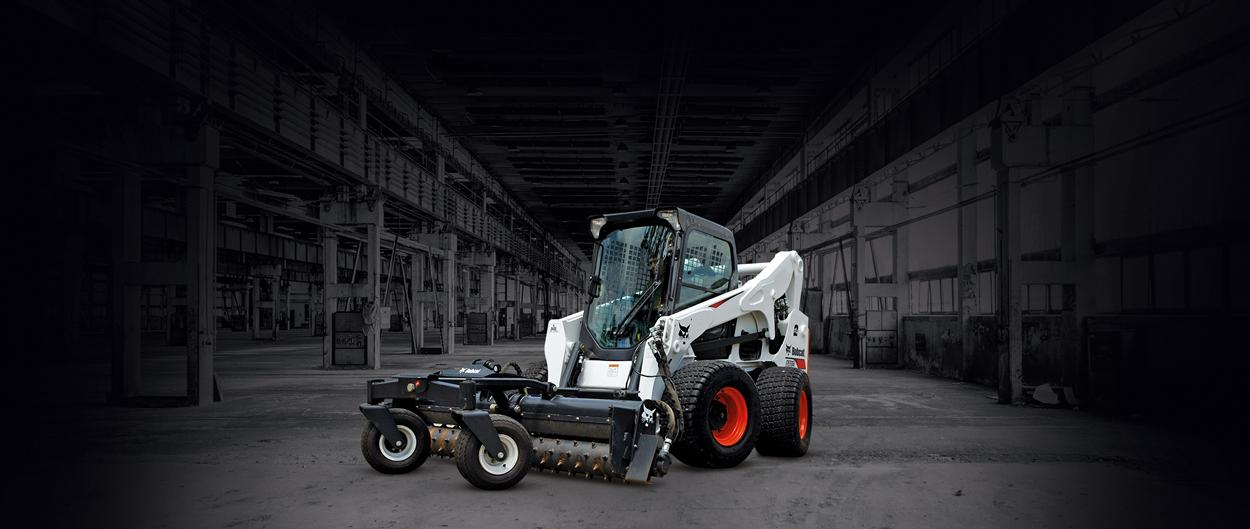 Bobcat A770 all-wheel steer loader with soil conditioner attachment.