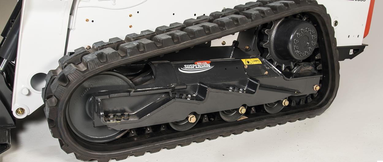 Closeup of undercarriage of a Bobcat T590 compact track loader with Roller Suspension System.