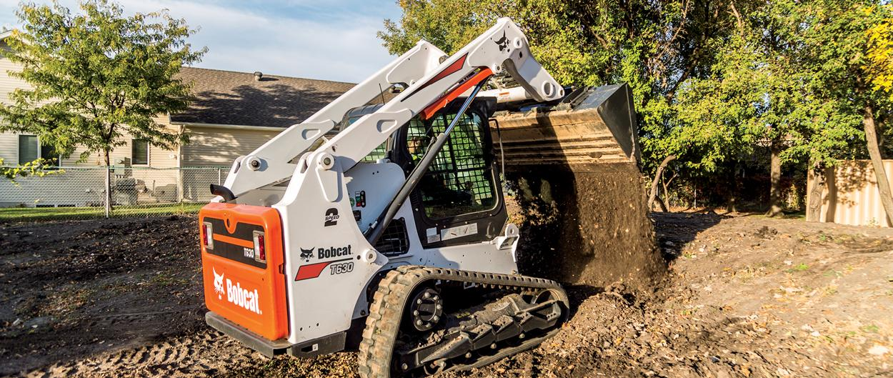 Bobcat T630 compact track loader dumping dirt.