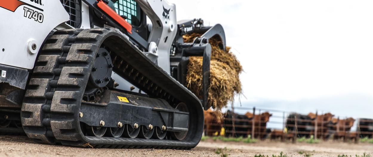 Bobcat T740 compact track loader tracks with grapple attachment.