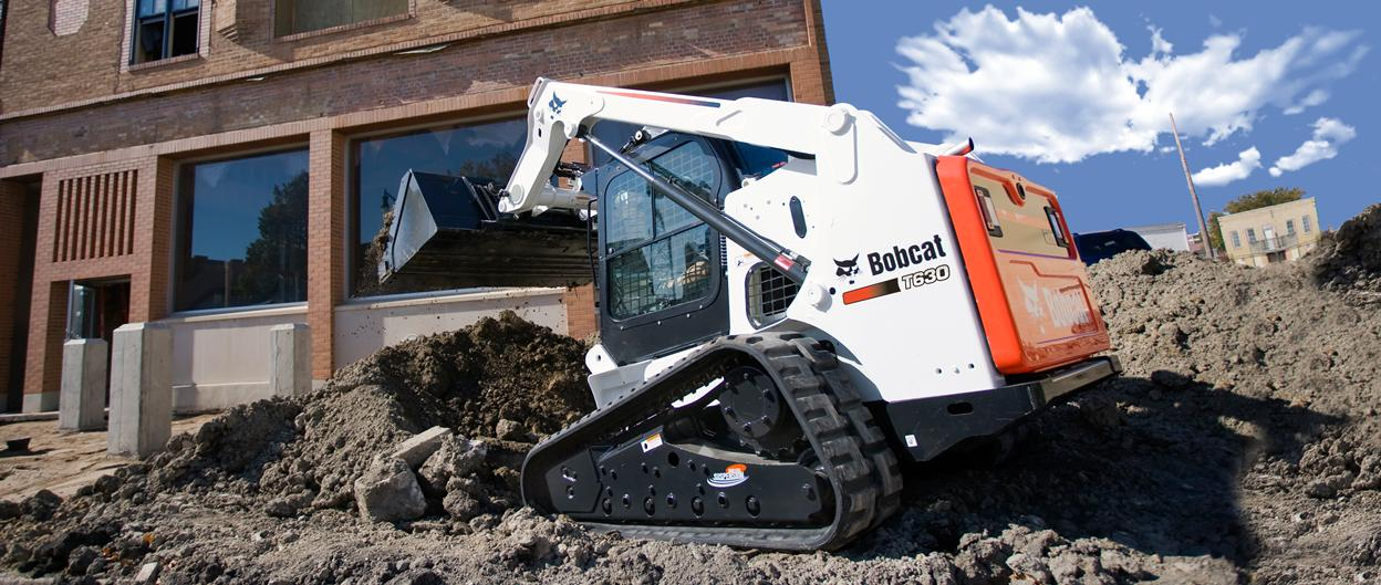 Bobcat T630 compact track loader with bucket.