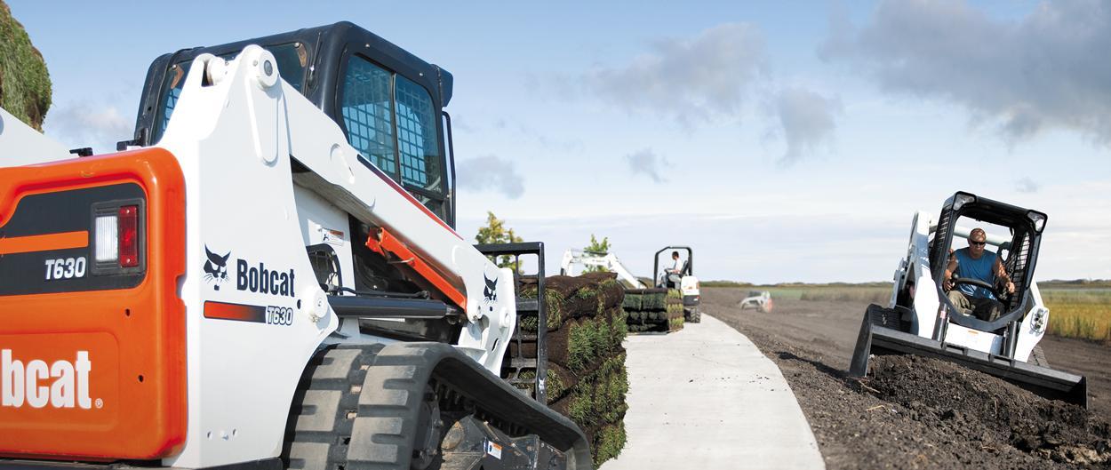 Bobcat compact track loader and skid-steer loader work on jobsite.