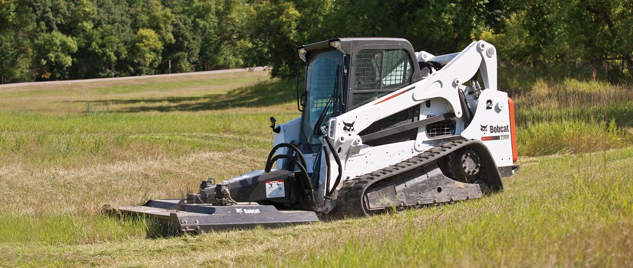 Bobcat T750 compact track loader with Brushcat rotary cutter attachment.