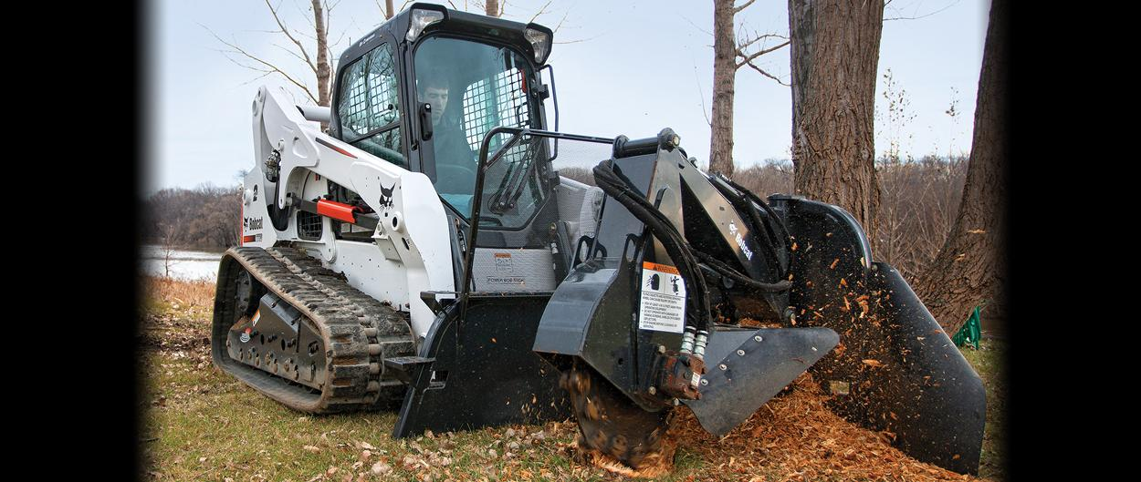 Bobcat compact track loader with stump grinder attachment.
