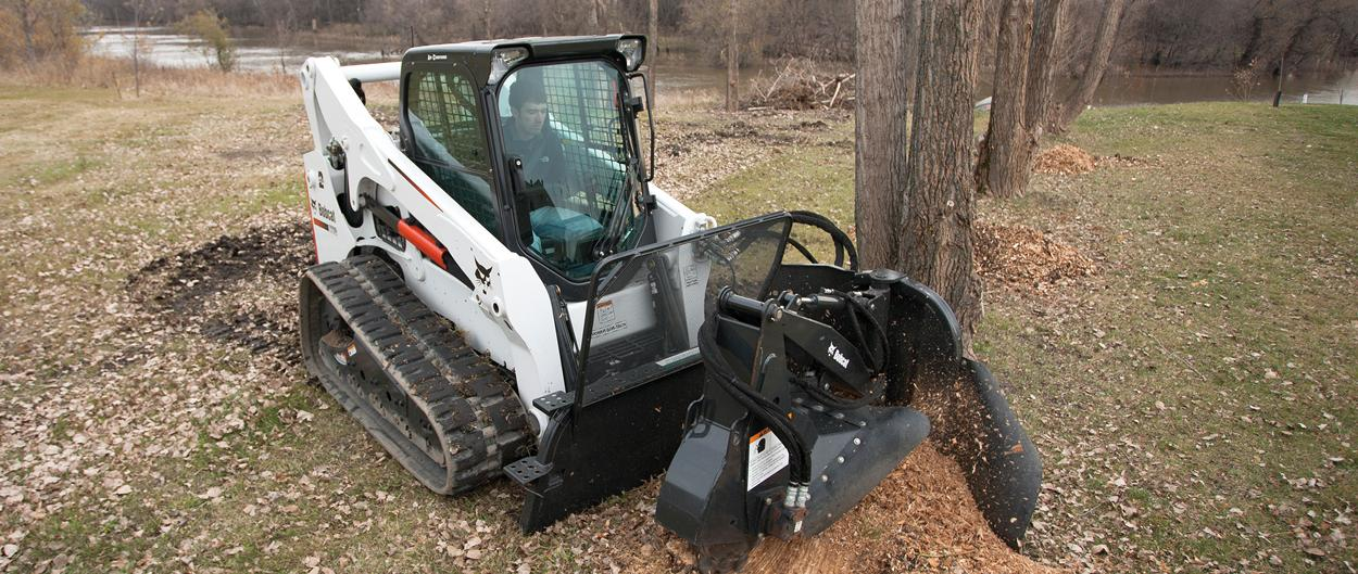Bobcat T770 compact track loader with stump grinder attachment.