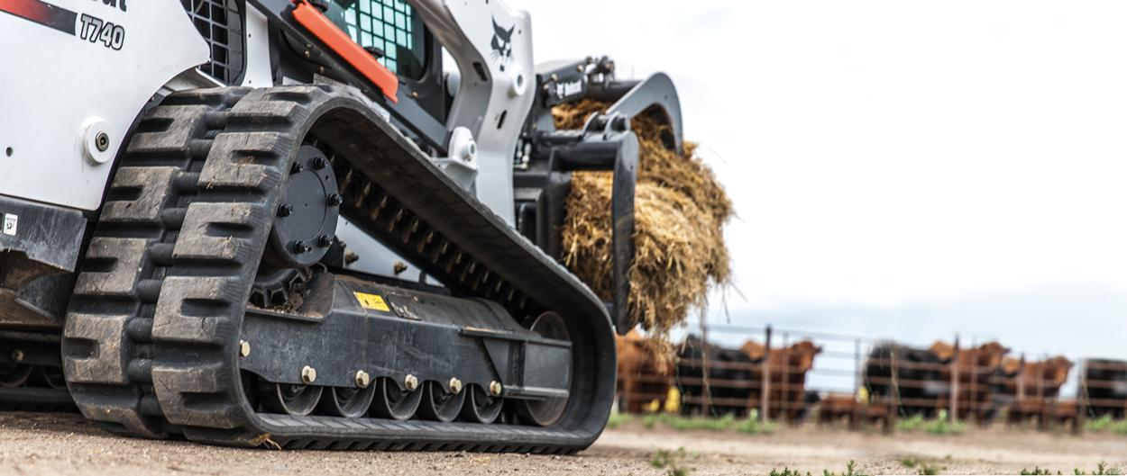 Bobcat T740 compact track loader uses a root grapple attachment.