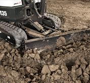 Bobcat compact excavator (mini excavator) with angle blade.