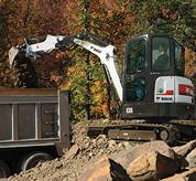 Bobcat compact excavator (mini excavator) with extendable arm.