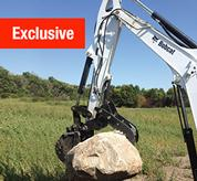 Pro Clamp system on a Bobcat compact (mini) excavator moving a large rock.