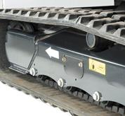 Bobcat excavator undercarriage and track showing dual flange roller system.