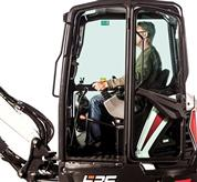 Compact (mini) excavator cab and operator.