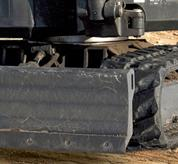 Bobcat (mini) excavator with reversible cutting edge.