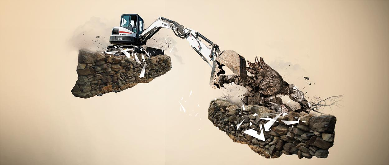 A Bobcat excavator expands its reach with the extendable arm option, clamping down on the arm of a rock creature that would otherwise be out of reach.