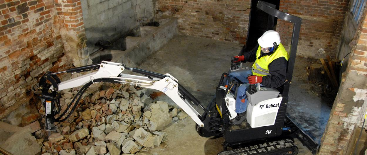 Bobcat 418 compact excavator (mini excavator) works in tight spaces.