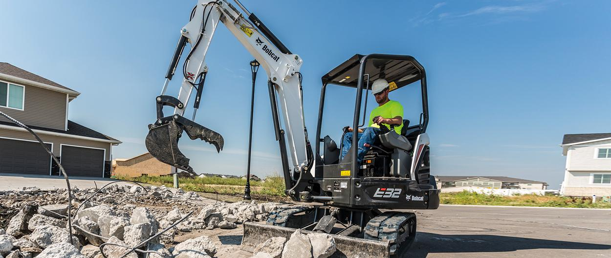 Bobcat R-Series E32 compact (mini) excavator with clamp attachment.