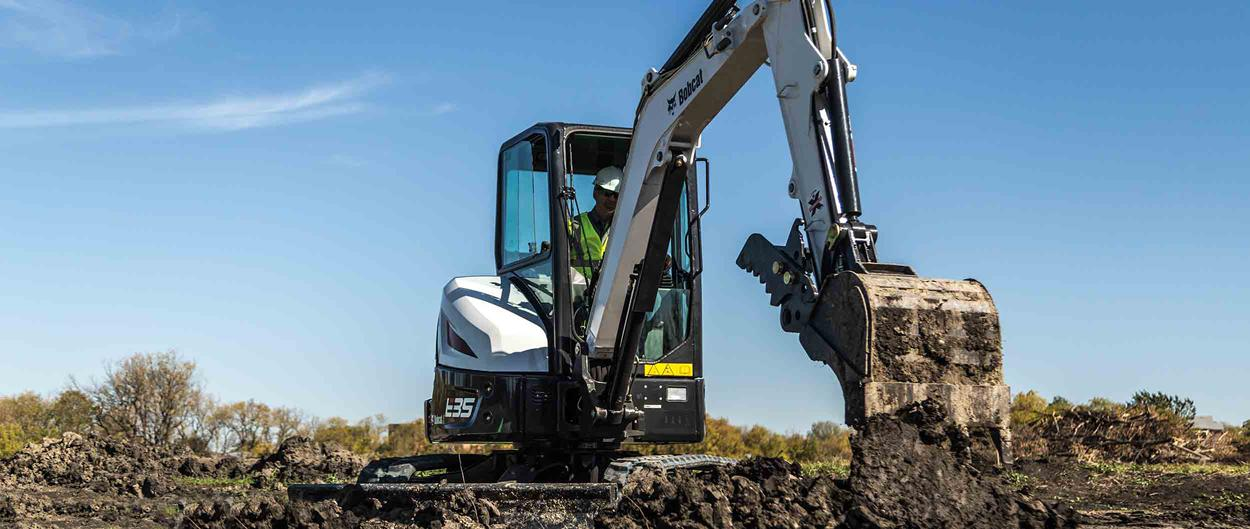 Bobcat E35 R-Series compact excavator with a clamp attachment.