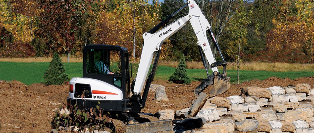 Bobcat E42 compact excavator (mini excavator) with clamp attachment.