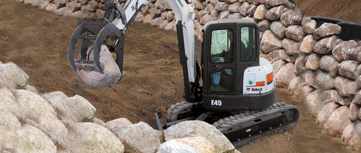Bobcat E45 compact excavator (mini excavator) with clamp attachment.