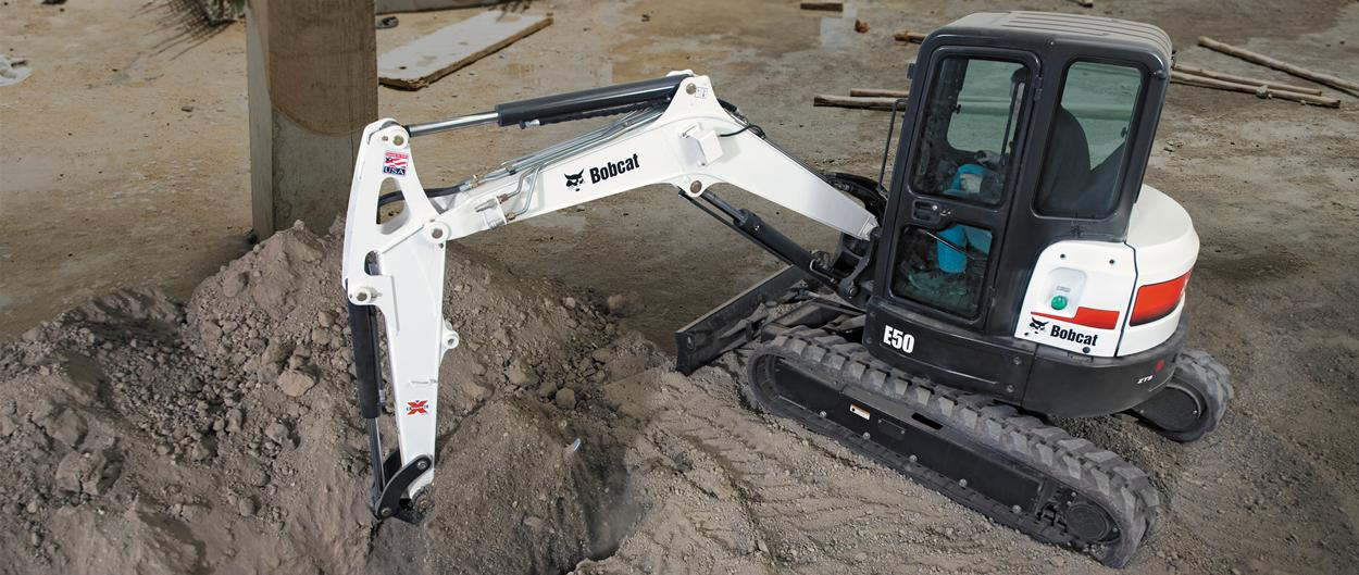 Bobcat E50 compact excavator (mini excavator) on crowded jobsite.