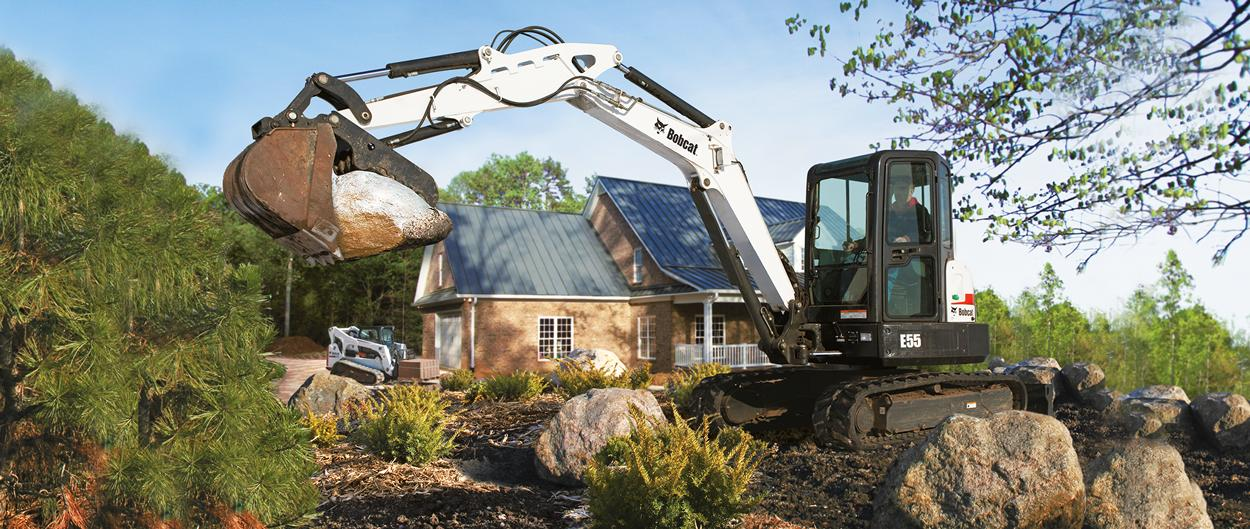 Bobcat E55 compact excavator (mini excavator) with clamp.