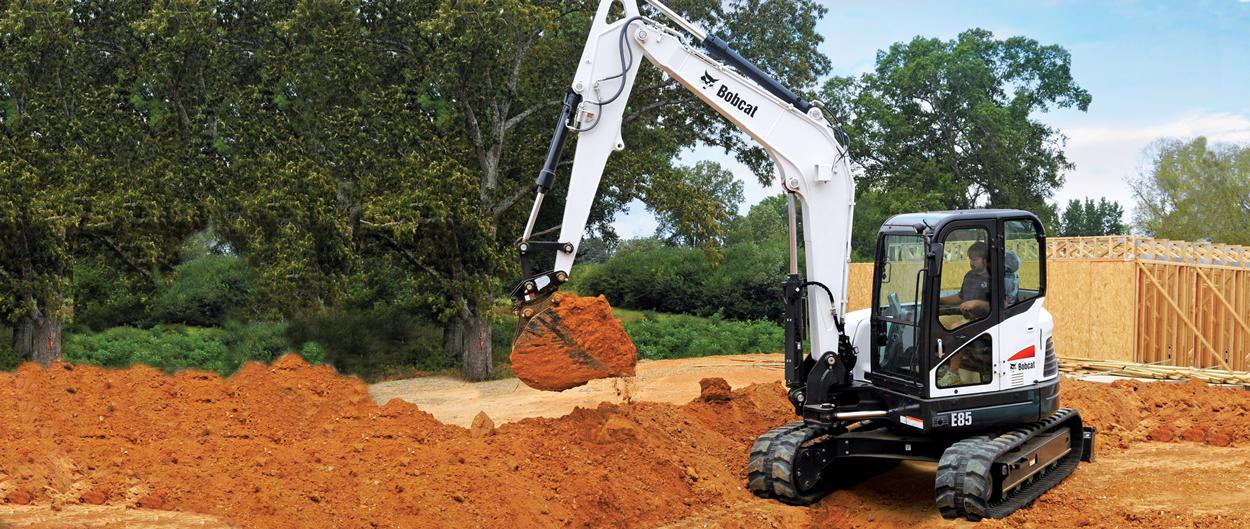 Bobcat E85 compact excavator on construction site.