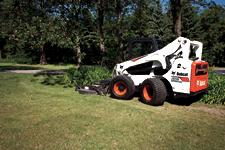Bobcat all-wheel steer loader with mower attachment.