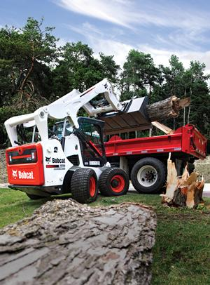 Bobcat all-wheel steer loader loads truck.