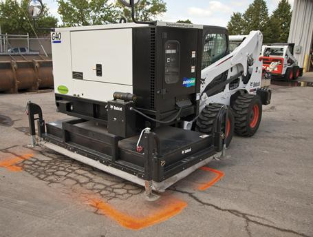 Infrared asphalt heater tool is placed over a damaged section of asphalt in a parking lot.
