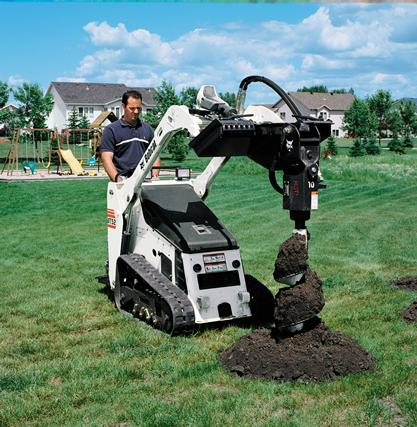 Auger attachment on an Bobcat MT52 mini track loader is used to dig a fence posthole.