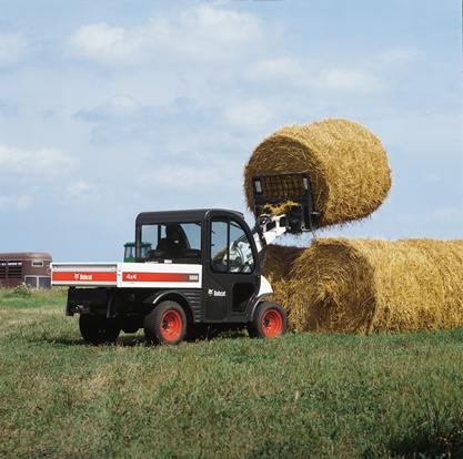 5600 Toolcat utility work machine uses the Bobcat bale fork (bale spear) attachment to lift a hay bale.