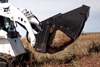 Bobcat combination bucket attachment on a compact loader.