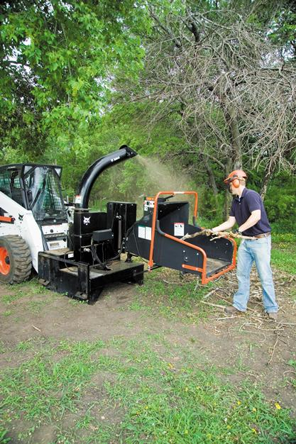 Bobcat chipper attachment grinds, mulches, and chips tree branches and limbs.