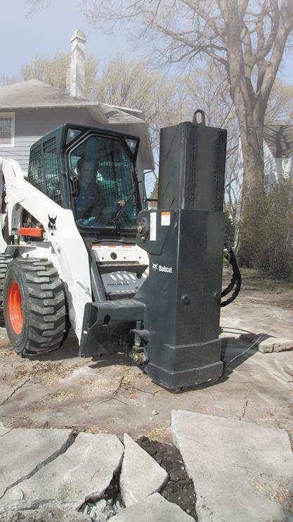 Break and demolish concrete with the drop hammer attachment.