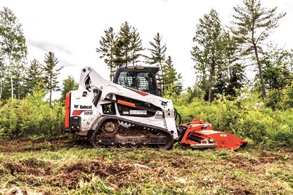 Bobcat flail cutter (mower) is used to cut down overgrown weeds.