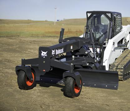 Bobcat compact track loader with grader attachment.