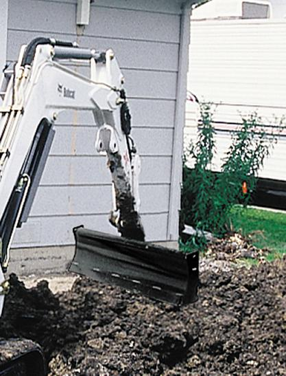 Bobcat grader blade attachment mounted on a compact excavator.