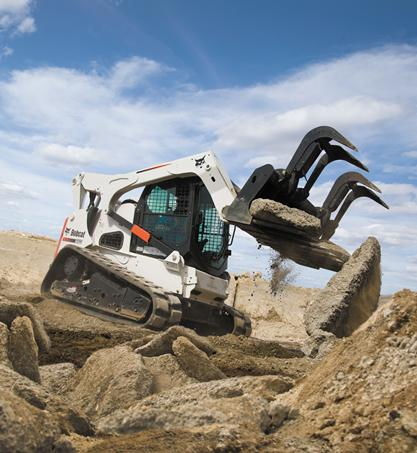 Bobcat industrial grapple attachment lifts large chunks of concrete.
