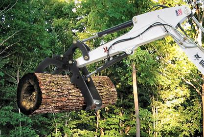 Three tine grapple for Bobcat excavators grabs a large log.