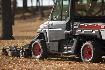 Side profile of Bobcat UTV mower attachment mounted on a 3650 utility vehicle.