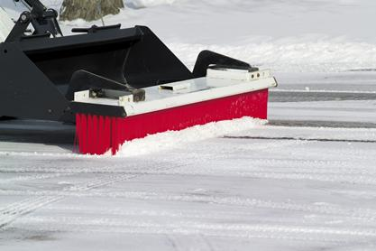 Side profile of Bobcat push broom attachment clearing snow.
