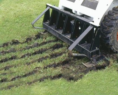 Bobcat scarifier attachment rips hard sod for removal.