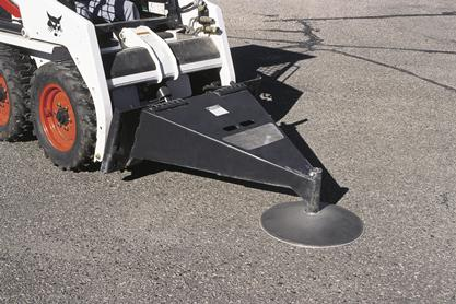 Scraper attachment mounted on a Bobcat skid-steer loader.