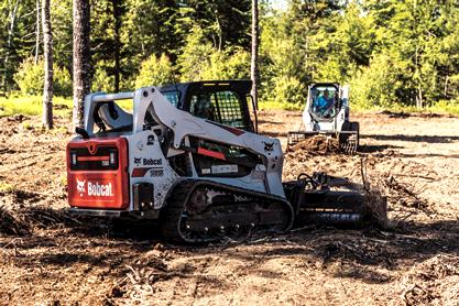 Bobcat soil conditioner is used to prepare soil in a city park.