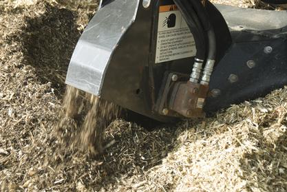 Close-up of Bobcat stump grinder attachment grinding a tree stump.