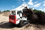 Bobcat T650 compact track loader dumping dirt with a bucket.