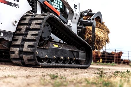 Bobcat T740 compact track loader with standard undercarriage scoops feed.
