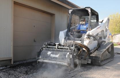 Bobcat T750 compact track loader and planer attachment.