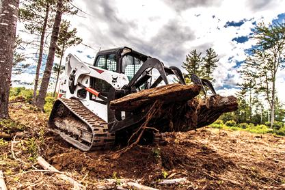 Bobcat T770 Compact Track Loader hauling material with root grapple.