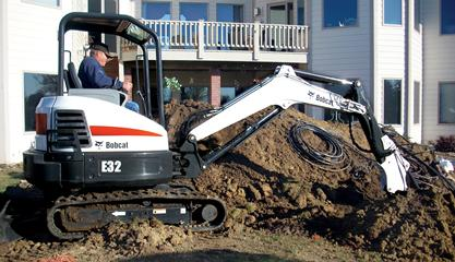 Bobcat compact excavator (mini excavator) with extendable arm.